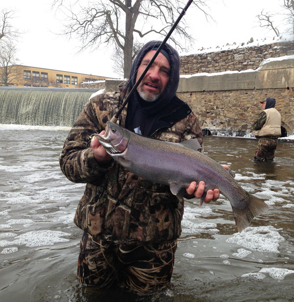 Greg holds up a nice steelhead from Johnson's Creek, NY. Anglers willing to brave cold weather can really bonus-out on the winter steelhead fishing.