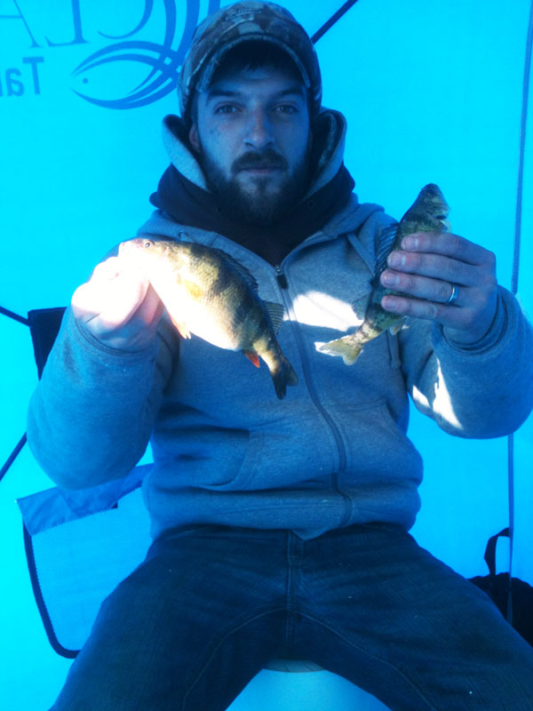 """Chunky perch like the large female Matt is holding up are """"bonus"""" fish for the fry pan."""