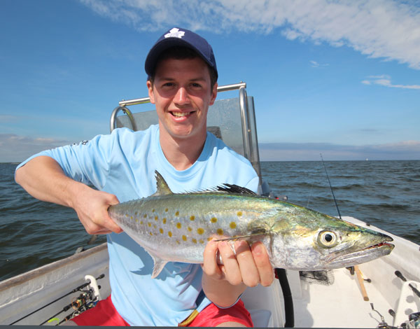 """Way-to-go Steve!! He landed this trophy Spanish Mackerel using his new """"Christmas present""""...great way to get a fishing outfit acquainted with fish!!"""