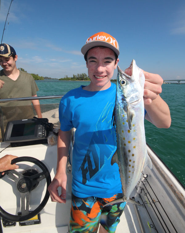 "Ben holds up one of the many ""Pass"" Spanish Mackerel that can be caught all winter long."