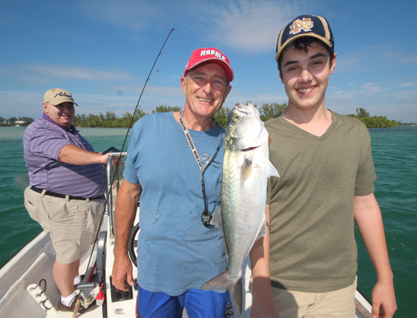 Conner holds up one of the biggest Bluefish of the day that hit a fresh shrimp fished on a drop-shot rig.