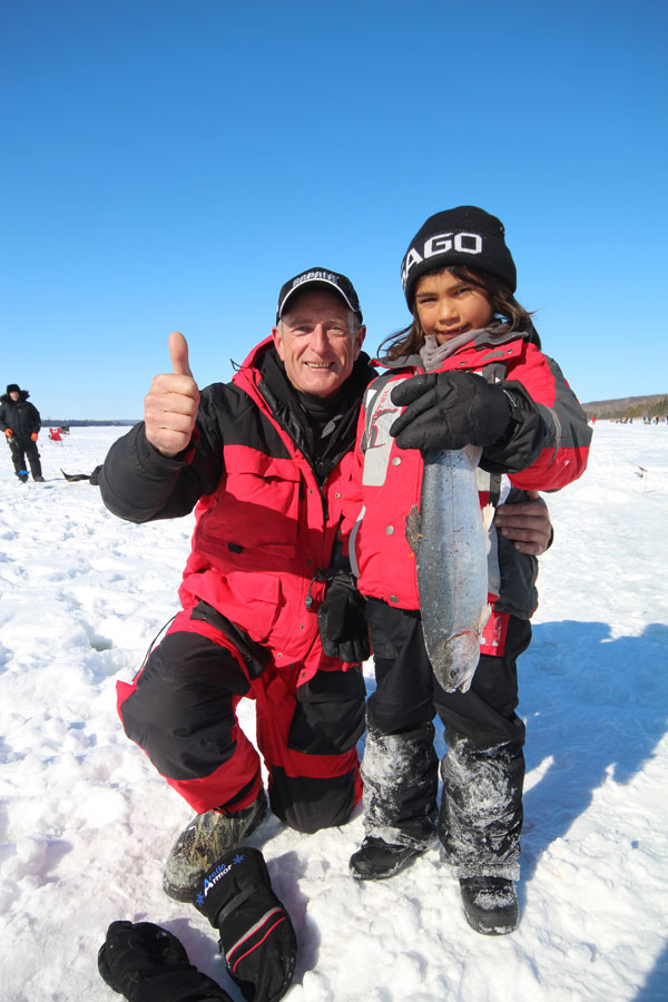 Many children, women and men entered the 6th Annual Wikwemikong Ice Fishing Derby and many of them caught winning rainbows!