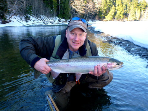 "Dennis Therrien with a beautiful Kalum River Steelhead landed this winter. Not a big one but a beauty just the same. Any Steelhead, no matter what the size, we always say is ""beautiful"". We are so lucky to have these fish."