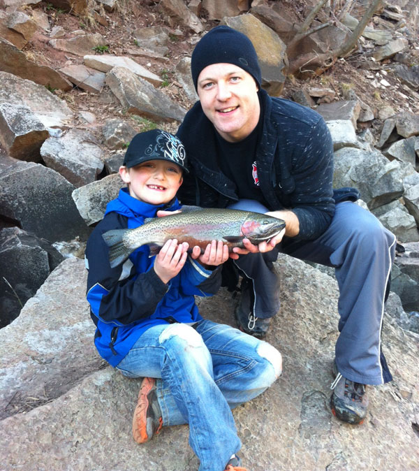 Ryan and Dad Tyler hold up one of several rainbows they caught fishing live minnows from shore on the Lower Niagara.