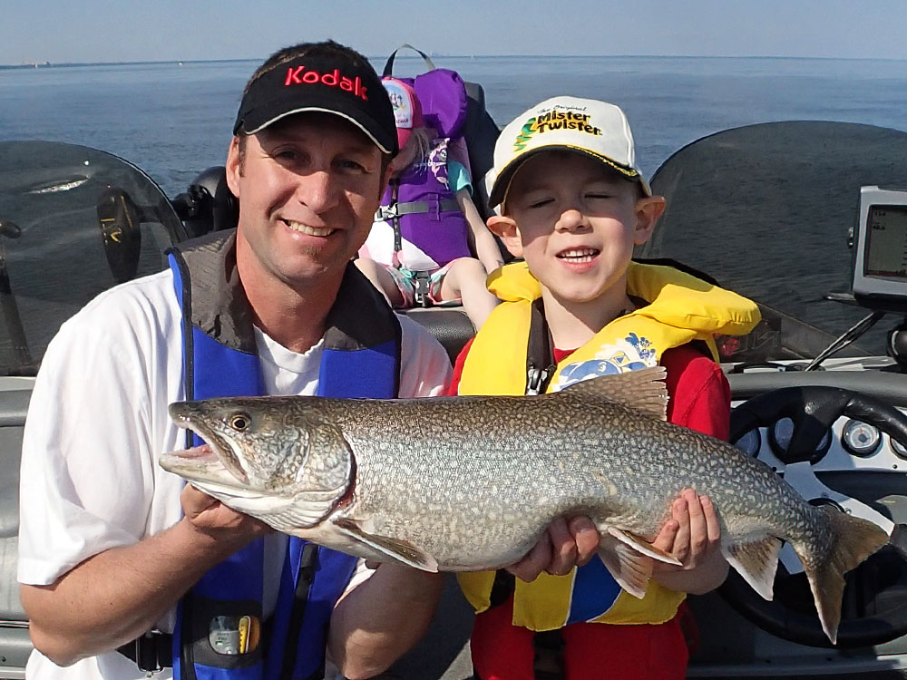 My proud son with his first lake trout