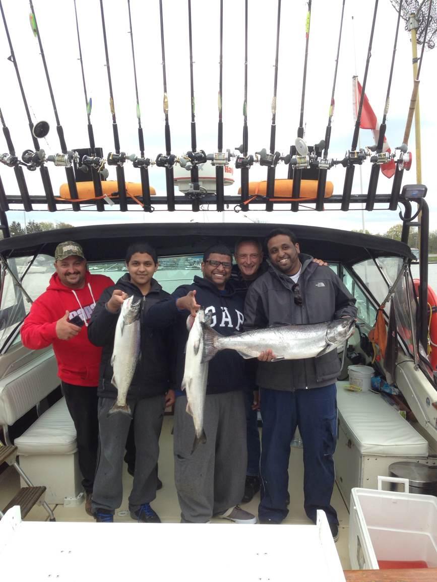 A happy group fishermen on an Niagara Fishing Adventures Lake Ontario charter.