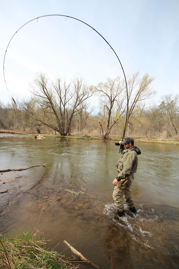 """Aaron puts """"maximum-pressure"""" on his trophy steelhead by holding his fishing rod at the 12 o'clock position to maximize the torque the rod can exert."""