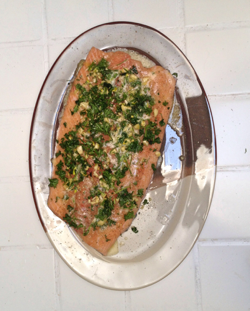 A freshly caught boneless salmon fillet section with the skin on, properly seasoned & ready for the barbecue.